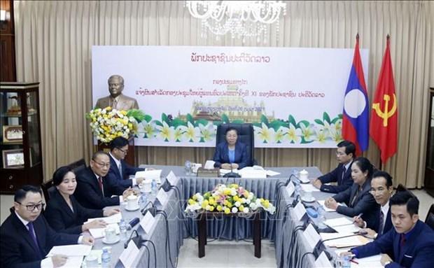 老挝人民革命党向越南共产党通报第十一次全国代表大会的结果 hinh anh 1