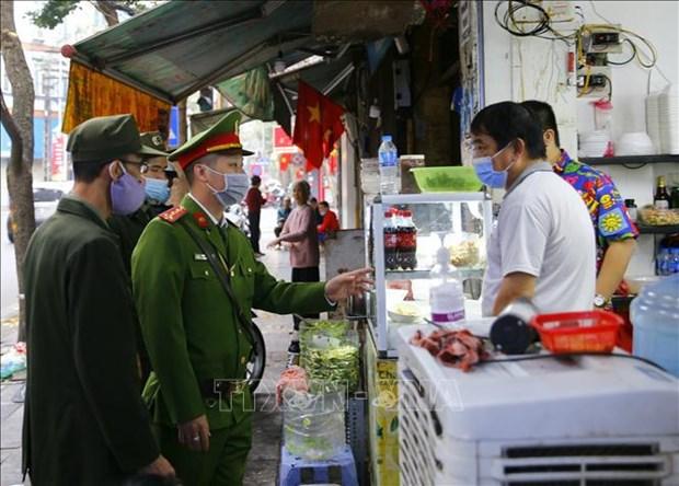 从5月3日下午起胡志明市及河内暂时关闭许多不必要的服务场所 hinh anh 2
