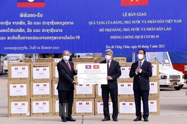 新冠肺炎疫情:越南向老挝提供50万美元的紧急援助 hinh anh 1