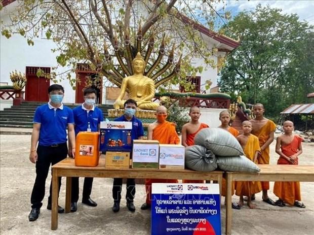 新冠肺炎疫情:旅居老挝越南人同所在地政府携手应对疫情 hinh anh 1