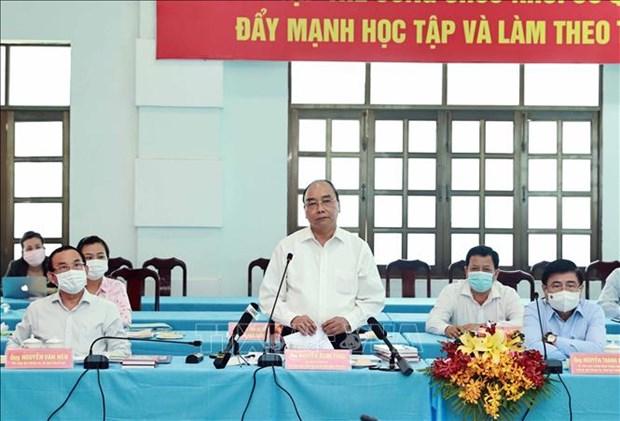 国家主席阮春福:古芝县和霍门县要充分开发现有潜力 加速发展步伐 hinh anh 1