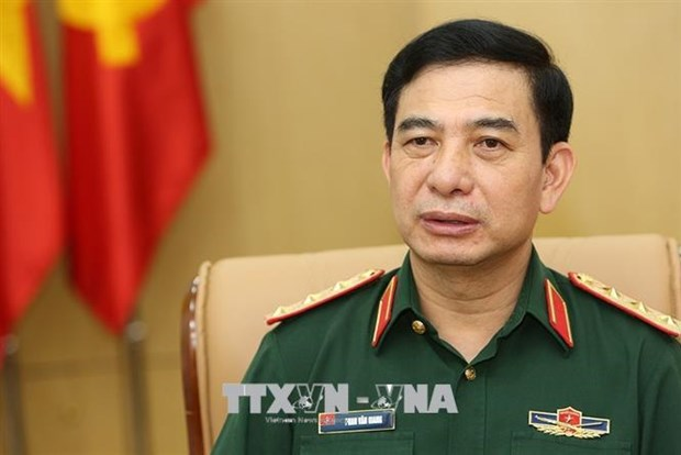 越老两国国防部长举行线上会谈 hinh anh 1