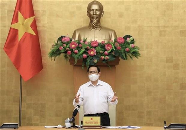 政府总理范明政:目前最重要的目标是确保社会安全和守护好群众的健康 hinh anh 2