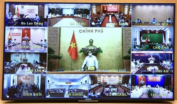 政府总理范明政:目前最重要的目标是确保社会安全和守护好群众的健康 hinh anh 1
