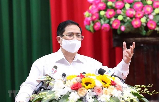 越南政府总理范明政:选民的意见是候选人继续完善其行动计划的基础 hinh anh 1