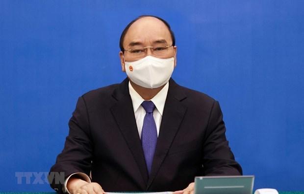 越南国家主席阮春福与日本首相菅义伟通电话 hinh anh 1