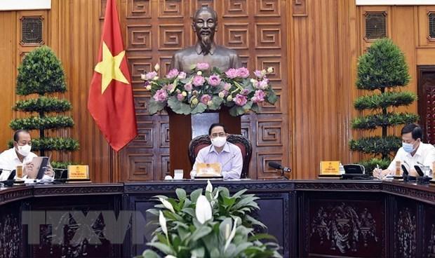 范明政总理:制定疫情之下开展换届选举工作的各种情景 hinh anh 1
