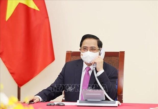 越南政府总理范明政与泰国总理巴育·占奥差通电话 hinh anh 1