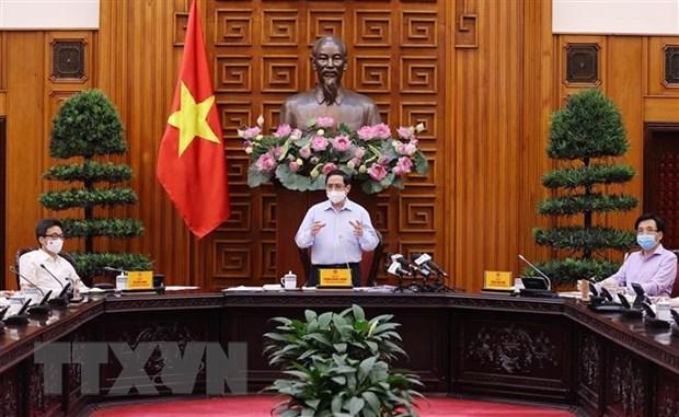 政府总理范明政:卫生部要攻坚克难,把人民群众健康安全摆在首要位置 hinh anh 2