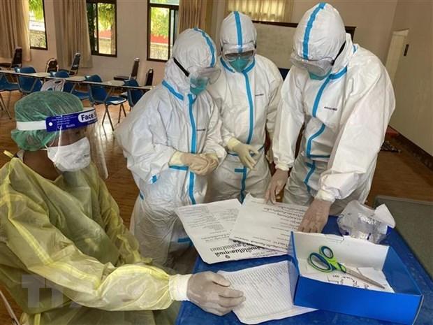 越南军事医学专家代表团出色完成支援老挝国防部抗击新冠状肺炎疫情任务 hinh anh 1