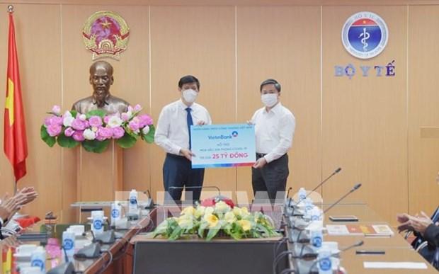 越南银行业和企业、集团向新冠肺炎疫苗基金会提供援助 hinh anh 1