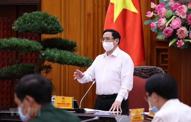 越南政府总理:应当确保工业区新冠疫情防控的安全 hinh anh 1