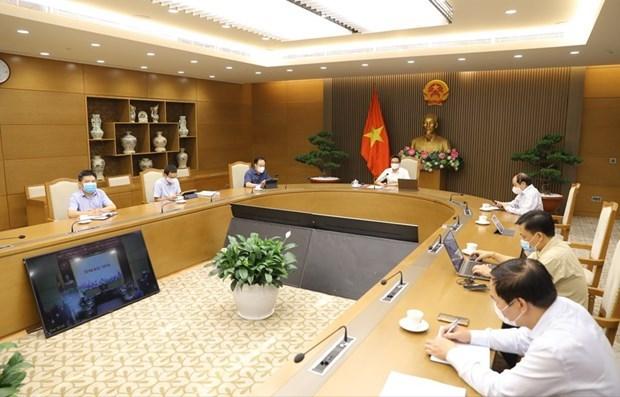 政府副总理武德儋:主动创新在各工业区开展防疫工作 hinh anh 1