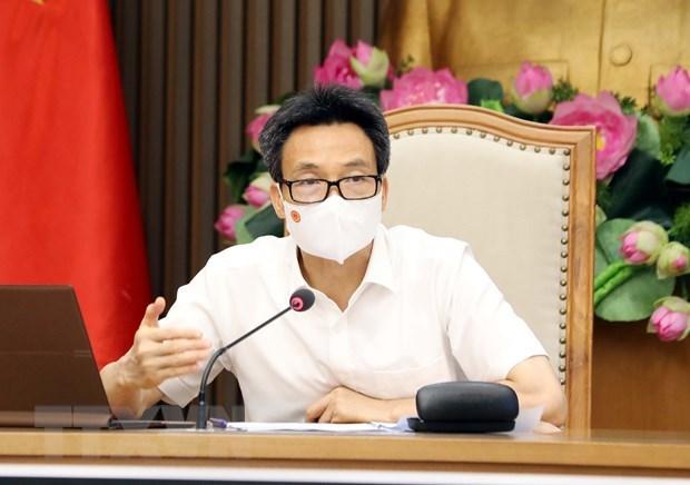 政府副总理武德儋:化解困难 尽早获得新冠疫苗 hinh anh 1