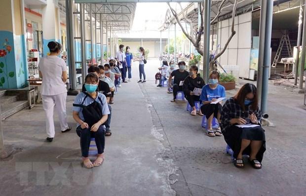 新冠肺炎确诊病例数超2万:各部门和地方政府加强协调配合 细化责任分工 hinh anh 2