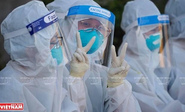 世卫组织:越南在处理各疫区中正走向正确的方向 hinh anh 1
