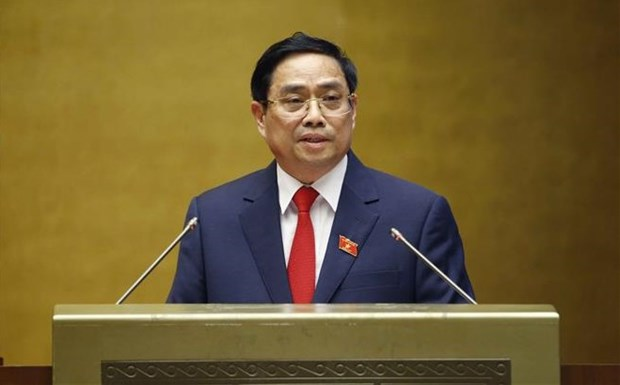 越南第十五届国会第一次会议:政府总理范明政:主动破除体制机制障碍 hinh anh 1