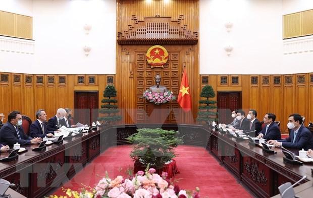 越南政府总理范明政会见瑞士联邦副总统兼外交部长卡西斯 hinh anh 1