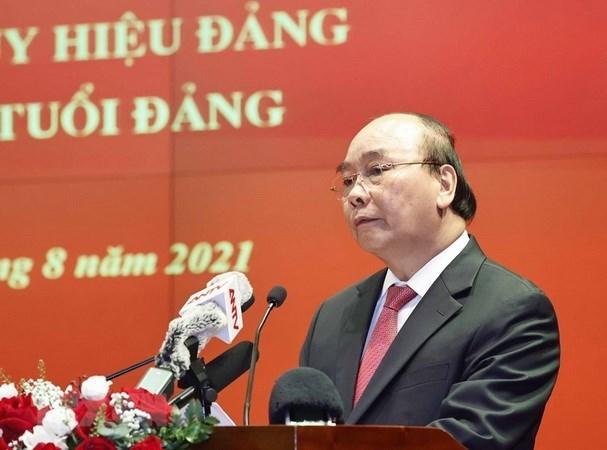 国家主席阮春福出席人民公安力量传统日76周年纪念见面会 hinh anh 1