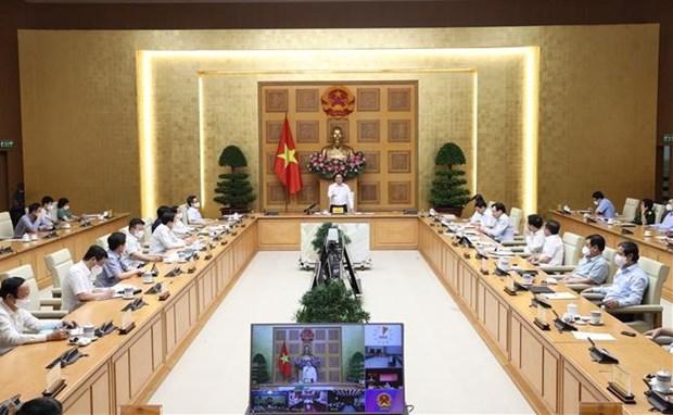 政府总理范明政:在实施社交距离地区做好就地医疗和后勤保障工作 hinh anh 1