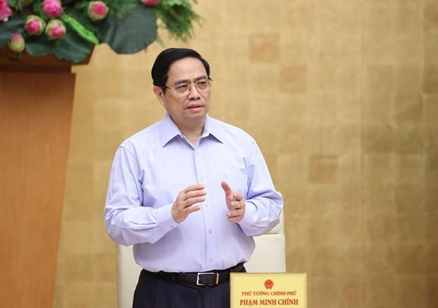 政府总理范明政要求加强实施社交距离措施 采取更有力的防疫措施 hinh anh 1