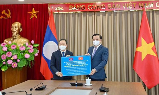越南首都河内与老挝万象加强多个领域合作 hinh anh 1