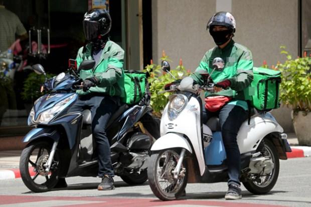 新冠疫情:自8月30日起胡志明市允许网约配送员在高风险区配送 hinh anh 1