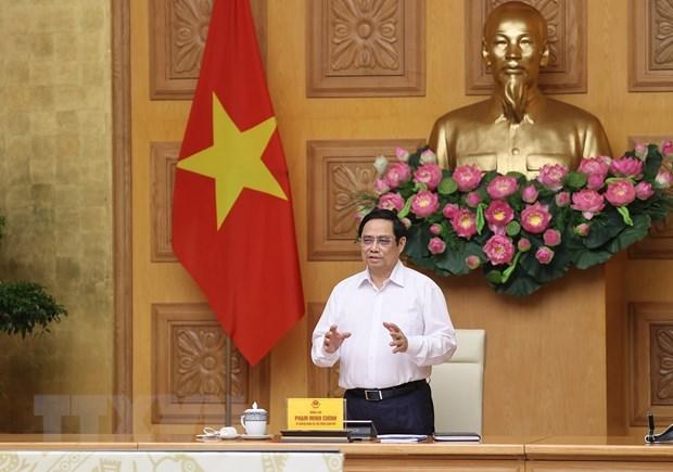 政府总理范明政:科学家和医务人员是防疫工作的重要支柱 hinh anh 1