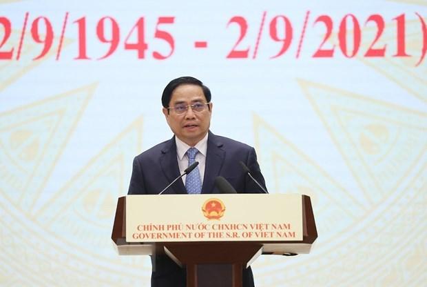 越南政府总理范明政出席2021年全球服务贸易峰会 hinh anh 1