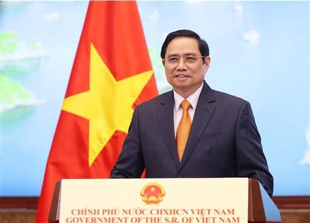 越南政府总理范明政在2021年全球服务贸易峰会上发表的重要讲话(全文) hinh anh 1