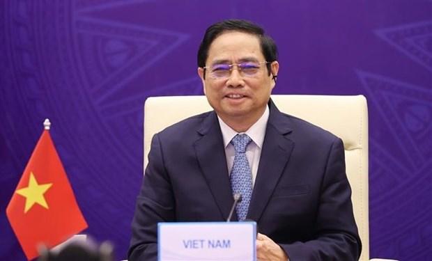 越南政府总理范明政出席大湄公河次区域经济合作第七次领导人会议 hinh anh 1