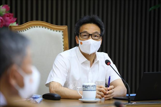 专家建议:根据国内实际情况调整防疫措施 hinh anh 1