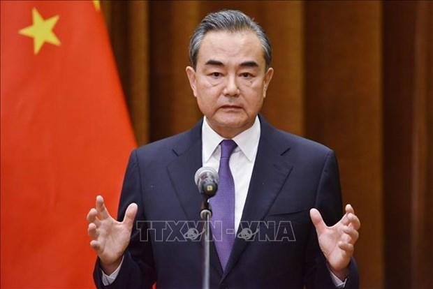 中国外长王毅开始访问柬埔寨之行 hinh anh 1