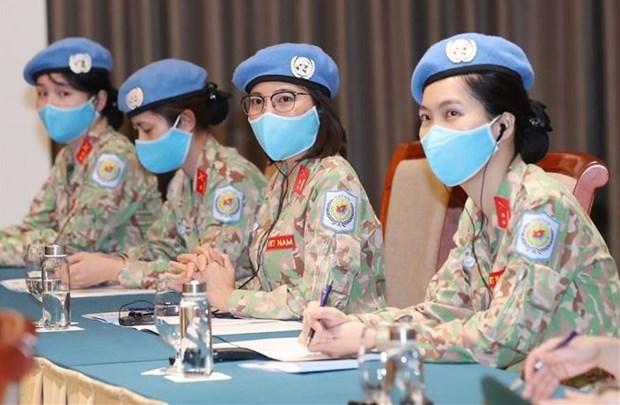 为提升妇女在全球和平和安全事务的参与度创造便利条件 hinh anh 1