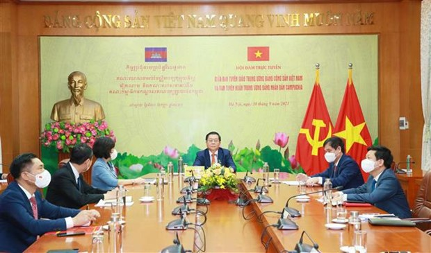 促进越共中央宣教部与柬埔寨人民党中央宣教委员会的合作 hinh anh 1