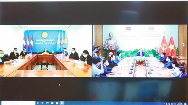 促进越共中央宣教部与柬埔寨人民党中央宣教委员会的合作 hinh anh 2