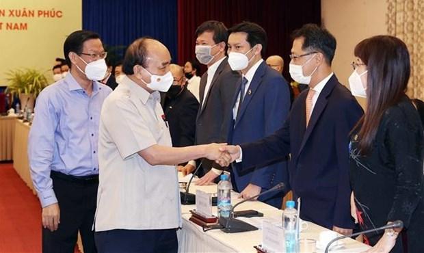 越南国家主席阮春福会见越南青年企业家代表 hinh anh 1