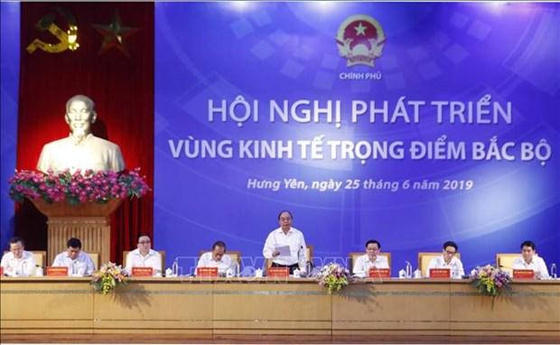 越南政府总理阮春福主持召开北部重点经济区发展会议 hinh anh 1