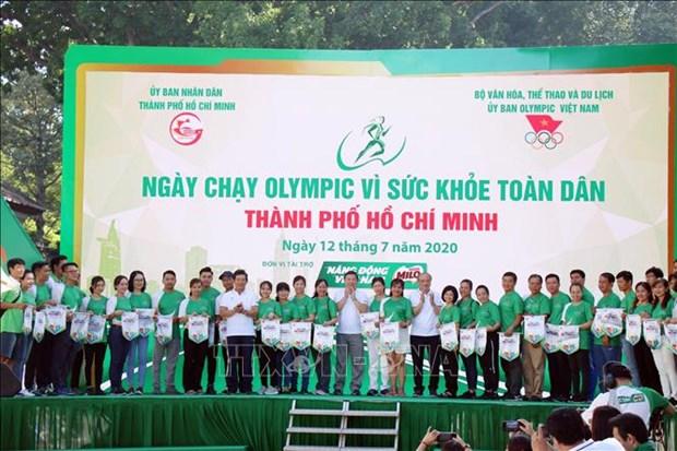 超过3万人参加胡志明市全民健康奥林匹克跑步日活动 hinh anh 1